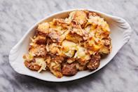 """You can simplify this side dish by using just one cheese, but the blend of all three will earn it (and you!) celebrity status. <a href=""""https://www.epicurious.com/recipes/food/views/fall-squash-and-leek-bread-pudding?mbid=synd_yahoo_rss"""" rel=""""nofollow noopener"""" target=""""_blank"""" data-ylk=""""slk:See recipe."""" class=""""link rapid-noclick-resp"""">See recipe.</a>"""