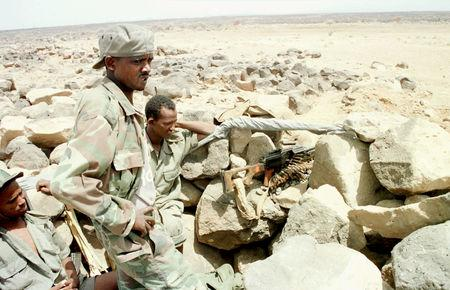 FILE PHOTO: Eritrean soldiers wait at the new line of defence at the Bure front May 30, 2000 near the Red Sea port of Assab./File Photo