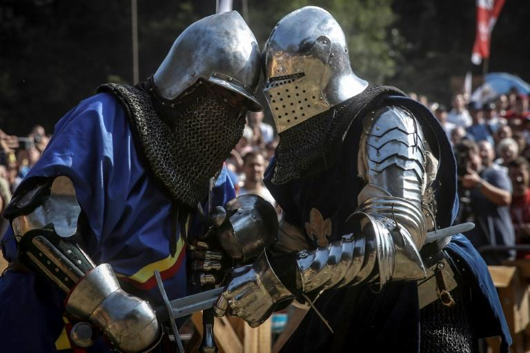 Two paarticipants in the Serbian medieval festival come together