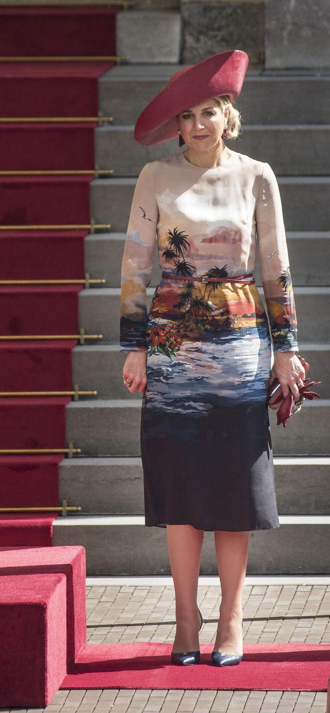 <p>She's unafraid to take risks, such as this tropical-print shift dress.</p>