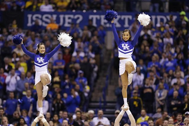 Kentucky cheerleaders perform before an NCAA Midwest Regional final college basketball tournament game against Michigan Sunday, March 30, 2014, in Indianapolis. (AP Photo/Michael Conroy)