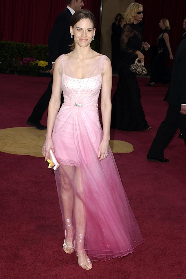 "Hilary Swank, 2003. John Galliano for Christian Dior appears in this list again, this time for making Swank wear a slip, realizing that the dress was unfinished, and then saying, ""But wait! We have tulle!"" Both admirers and critics dubbed this a ""ballerina-inspired"" outfit -- but really it was more like Maidenform meets Jo-Ann Fabrics. At least the outfit showed off her muscular legs, probably trained by her ""Million Dollar Baby"" stint, for which she'd win an Oscar the next year. Time for a boxer-inspired dress!"