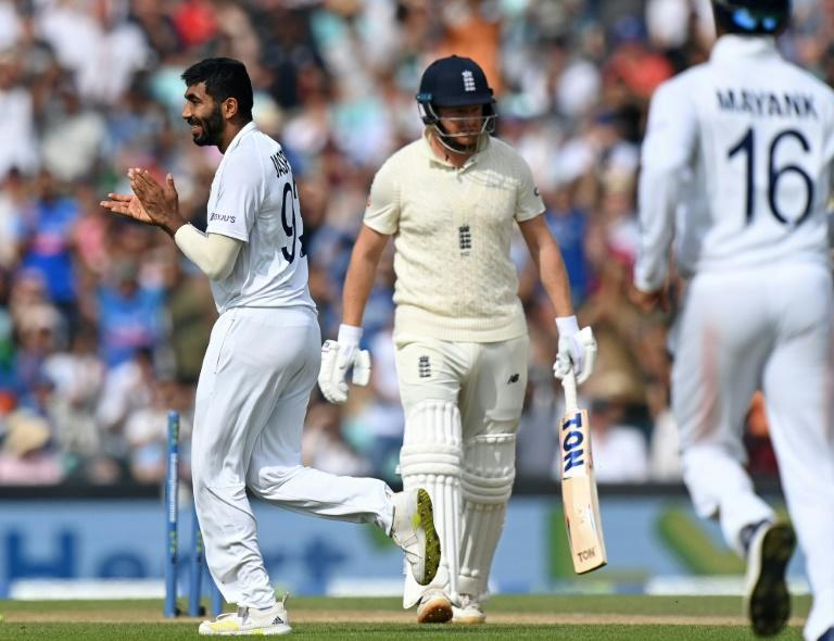 Deserved applause: India's Jasprit Bumrah (L) is delighted after bowling England's Jonny Bairstow for a duck in the fourth Test at the Oval (AFP/Glyn KIRK)