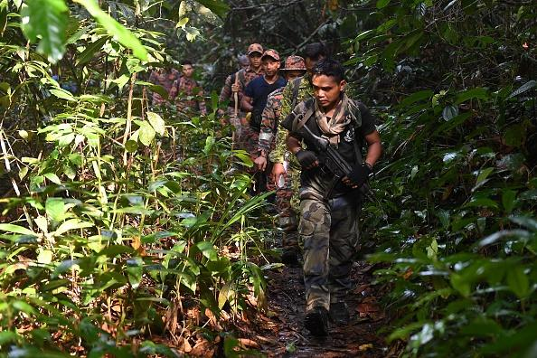 Members of a rescue team take part in a search effort to locate missing 15-year-old Franco-Irish teenager Nora Quoirin on Mount Berembun, Seremban.