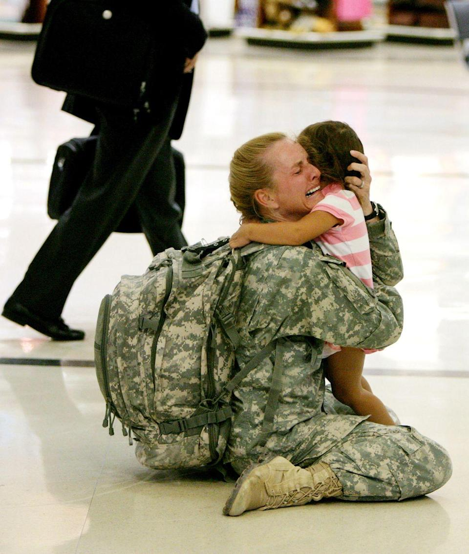 <p>2007. Terri Gurrola reacts as she greets her daughter Gabrielle Gurrola, 3, at the Atlanta Hartsfield-Jackson International Airport after returning from a seven month tour in Iraq.</p>