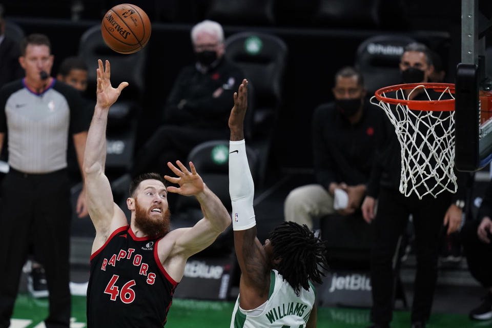 Toronto Raptors center Aron Baynes (46) shoots over Boston Celtics center Robert Williams III during the first half of an NBA basketball game, Thursday, March 4, 2021, in Boston. (AP Photo/Charles Krupa)