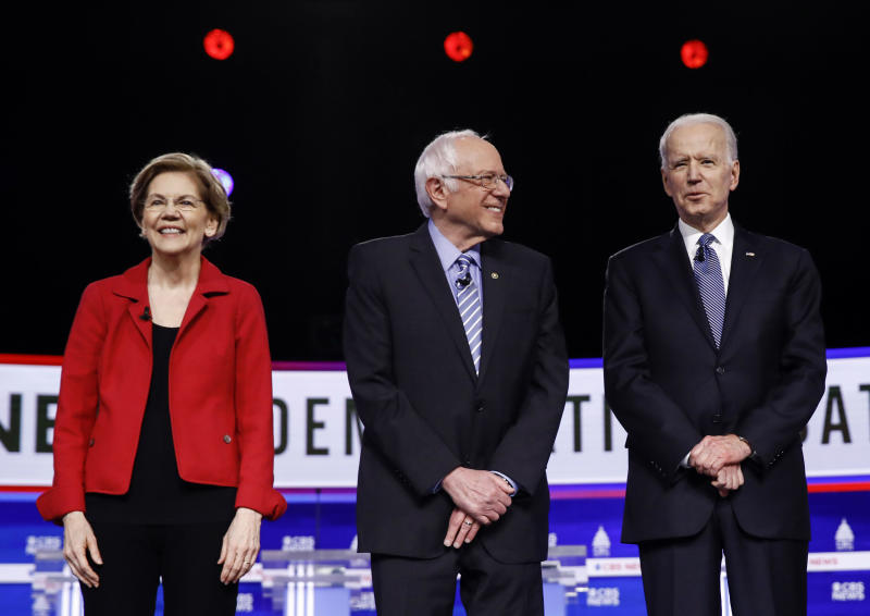 FILE - In this Feb. 25, 2020, file photo from left, Democratic presidential candidates, Sen. Elizabeth Warren, D-Mass., Sen. Bernie Sanders, I-Vt., former Vice President Joe Biden, and Sen. Amy Klobuchar, D-Minn., participate in a Democratic presidential primary debate in Charleston, S.C. Calls for pragmatic centrism helped Joe Biden clinch the Democratic presidential nomination. But they left many of the party's strongest liberals worried that little progress would be made toward their sweeping goals. (AP Photo/Matt Rourke, File)