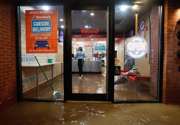 HOBOKEN, NJ - SEPTEMBER 1: Floodwaters make their way into a Domino's pizza restaurant caused by the remnants of Hurricane Ida drenching the New York City and New Jersey area on September 1, 2021 in Hoboken, New Jersey. (Photo by Gary Hershorn/Getty Images) (Photo: Gary Hershorn via Getty Images)
