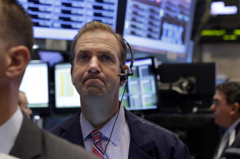FILE - In this Wednesday, Sept. 18, 2013, file photo, Trader Michael Smyth works on the floor of the New York Stock Exchange. Global stocks remained jittery Wednesday Oct. 2, 2013 on fears that a partial shutdown of the U.S. government could undermine the country's fragile economic recovery.(AP Photo/Richard Drew)