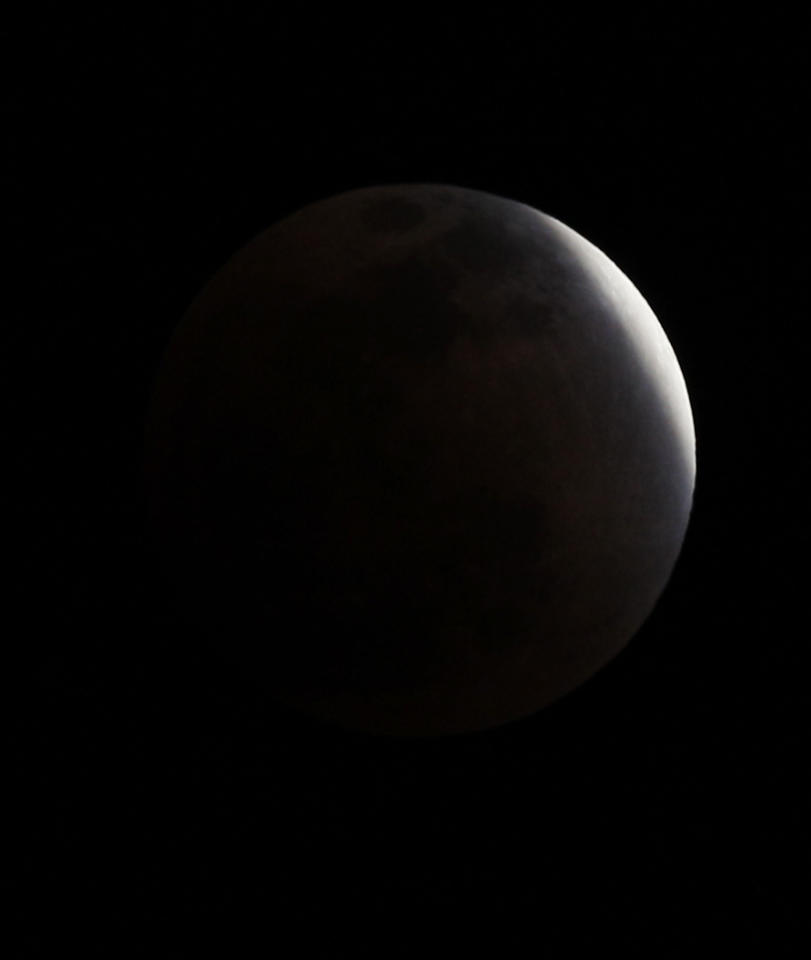 The Earth casts its shadow across the moon's surface during the lunar eclipse in Hong Kong, Saturday, Dec. 10, 2011. (AP Photo/Kin Cheung)