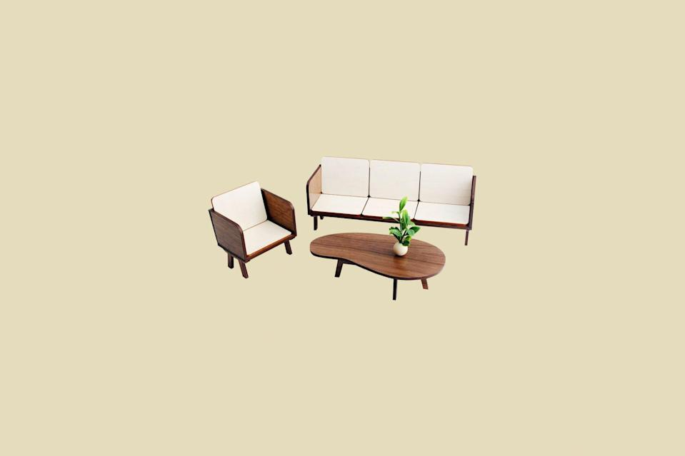 "<p>Why buy a mini midcentury style sofa when you can get a whole room set instead? This walnut and birchwood furniture kit includes a three-seat sofa, coordinating club chair, and a kidney-shaped coffee table to complete the tiny scene.</p> <p><strong><em>Shop Now:</em></strong> <em>3StarStudioArts The LOUNGE Living Room Set in Walnut, $34, <a href=""https://www.awin1.com/cread.php?awinmid=6220&awinaffid=272513&clickref=MSLTheMiniaturesTrendIsHavingaMomentTryOneofOurFavoriteKitssbamseyDIYGal7988105202009I&p=https%3A%2F%2Fwww.etsy.com%2Flisting%2F790255497%2Fthe-lounge-living-room-set-in-walnut-112"" rel=""nofollow noopener"" target=""_blank"" data-ylk=""slk:etsy.com"" class=""link rapid-noclick-resp"">etsy.com</a></em><em>.</em></p>"