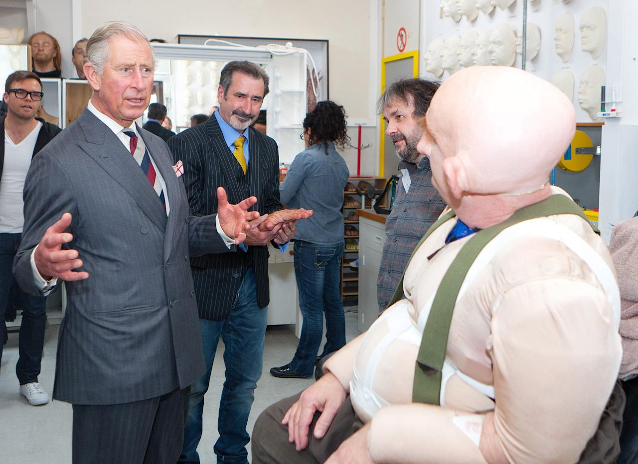WELLINGTON, NEW ZEALAND - NOVEMBER 14:  Prince Charles, Prince of Wales meets with Peter Hambleton, who plays the Dwarf Gloin in the new 'Hobbit' film, at Weta Workshop on November 14, 2012 in Wellington, New Zealand. The Royal couple are in New Zealand on the last leg of a Diamond Jubilee that takes in Papua New Guinea, Australia and New Zealand. (Photo by Jeff McEwan - PoolGetty Images)