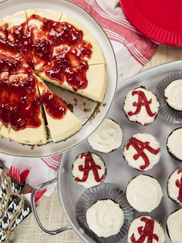 """<p>Tangy cream cheese frosting tops these crimson cupcakes.</p><p><span class=""""redactor-invisible-space""""><a href=""""https://www.womansday.com/food-recipes/food-drinks/recipes/a56190/red-velvet-cupcakes-recipe/"""" rel=""""nofollow noopener"""" target=""""_blank"""" data-ylk=""""slk:Get the Red Velvet Cupcakes recipe."""" class=""""link rapid-noclick-resp""""><em>Get the Red Velvet Cupcakes recipe.</em></a> </span></p>"""