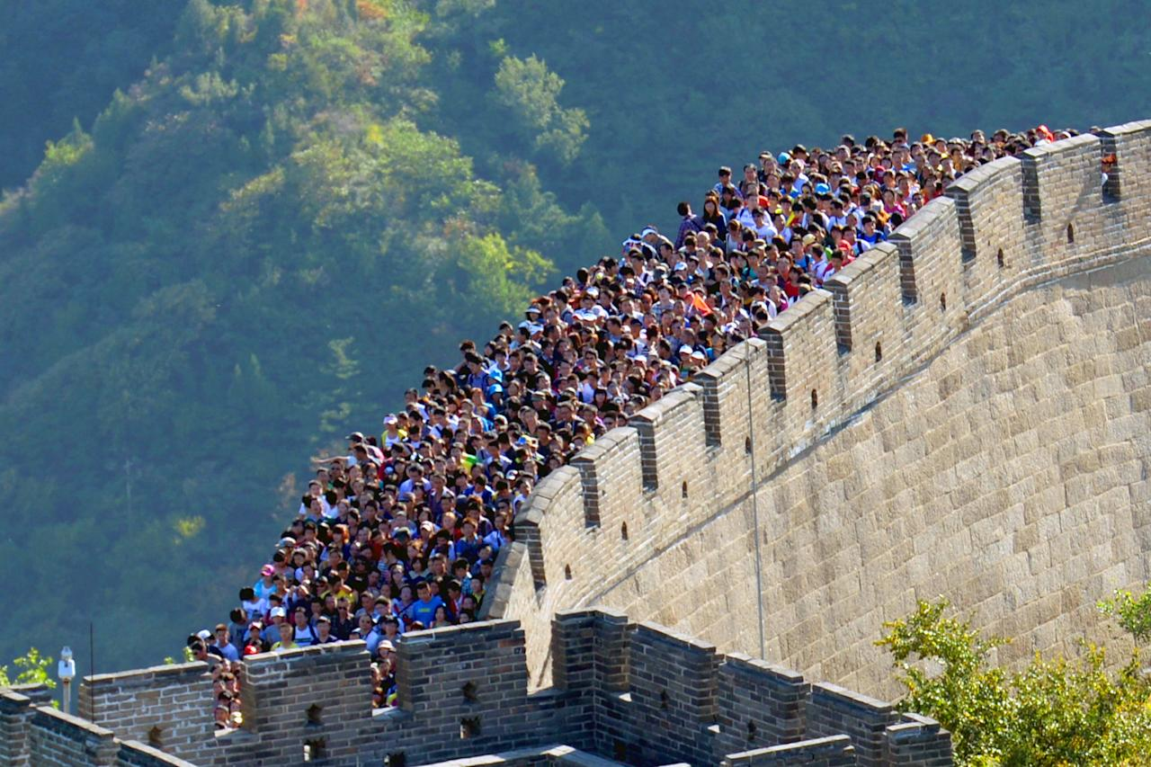 Huge crowds of tourists pack on to the Badaling Great Wall of China on Wednesday as extended national holidays brought many attractions to a virtual standstill. The China Tourism Academy estimated there would be 362 million travelers on the move this holiday. (Rex)