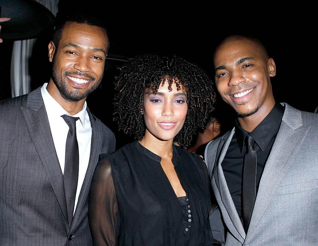 "Annie Ilonzeh (who briefly starred on the ""Charlie's Angels"" reboot) looked happy to have two guys at her side -- ""Old Spice Guy"" Isaiah Mustafa (left) and actor Mehcad Brooks. (11/17/2011)"