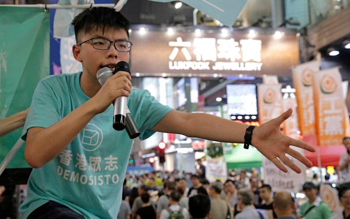 Some of the missing books include one written by prominent democracy advocate Joshua Wong - Kin Cheung/AP