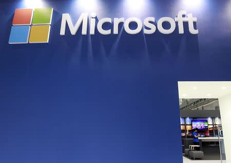 A employee stands in the Microsoft booth during the 2014 Computex exhibition at the TWTC Nangang exhibition hall in Taipei