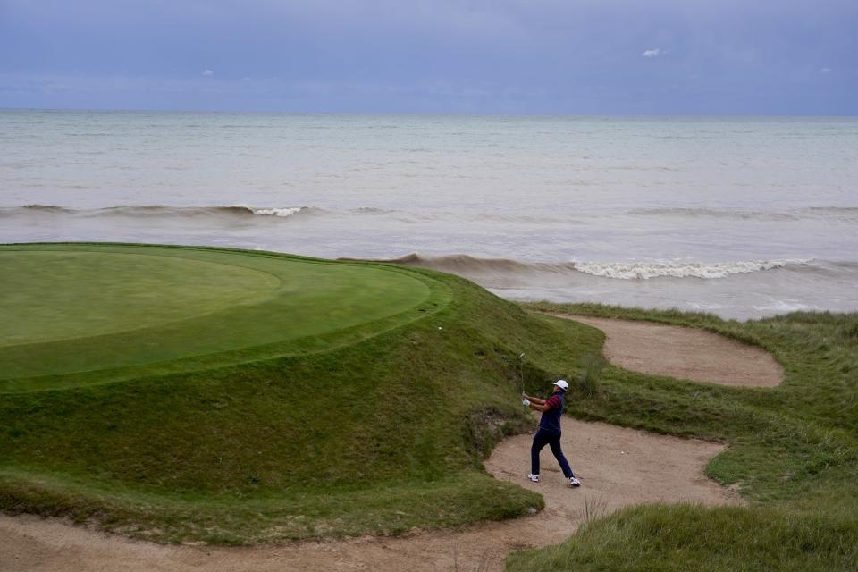 Team USA's Xander Schauffele hits to the third green during a practice day at the Ryder Cup at the Whistling Straits Golf Course Thursday, Sept. 23, 2021, in Sheboygan, Wis. (AP Photo/Jeff Roberson)
