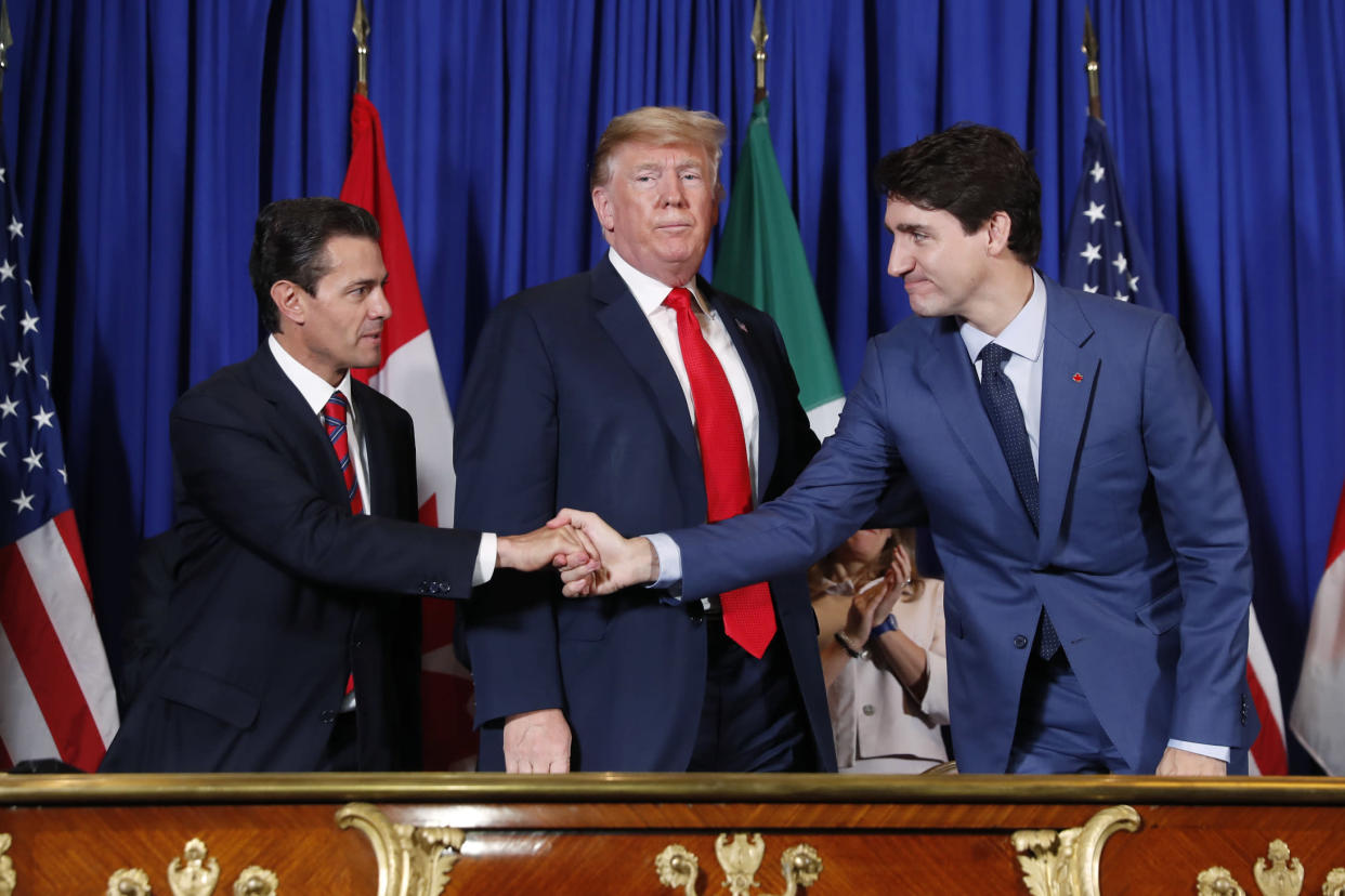 President Trump, Canada's Prime Minister Justin Trudeau, right, and Mexico's President Enrique Pena Neto, left, participate in the USMCA signing ceremony on Friday in Buenos Aires, Argentina. (Photo: Pablo Martinez Monsivais/AP)