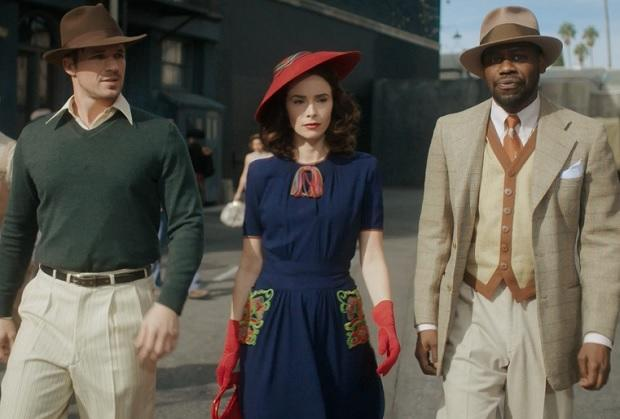 When the Timeless trio travels to 1940s Hollywood this Sunday (NBC, 10/9c), Lucy, Wyatt and Rufus are forced to improvise— to varying degrees of success — in order to maintain their cover. In TVLine's exclusive sneak peek, a movie studio guard confronts the Time Team and asks to see their IDs. Luckily, Rufus is (kind […]