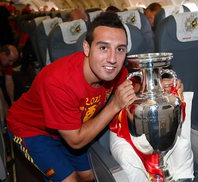 IN FLIGHT - JULY 02: In this handout image supplied by the Royal Spanish Football Federation, Santi Cazorla of Spain poses with the trophy following his team's victory in the UEFA EURO 2012 final match against Italy onboard the Spain team's airplane during their flight back to Madrid on July 2, 2012 in flight. (Photo by Carmelo Rubio Sanchez/RFEF via Getty Images)