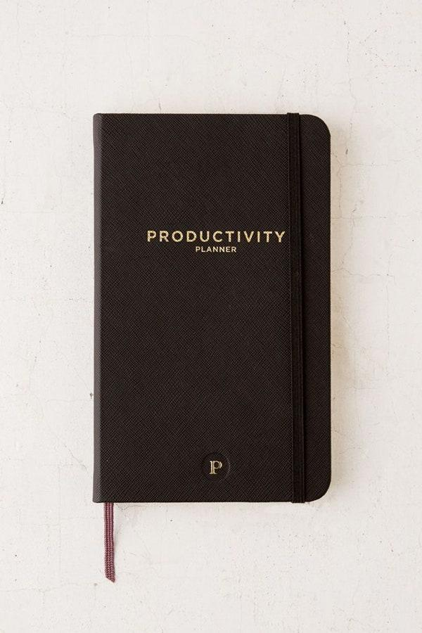 "This planner from Urban Outfitters will help you put your procrastinating days behind you with its Pomodoro style work system which allows you to rate your productivity at the end of each day. $26, Urban Outfitters. <a href=""https://www.urbanoutfitters.com/shop/productivity-planner?category=SEARCHRESULTS&color=001&searchparams=q%3Dplanner&type=REGULAR&size=ONE%20SIZE&quantity=1"" rel=""nofollow noopener"" target=""_blank"" data-ylk=""slk:Get it now!"" class=""link rapid-noclick-resp"">Get it now!</a>"