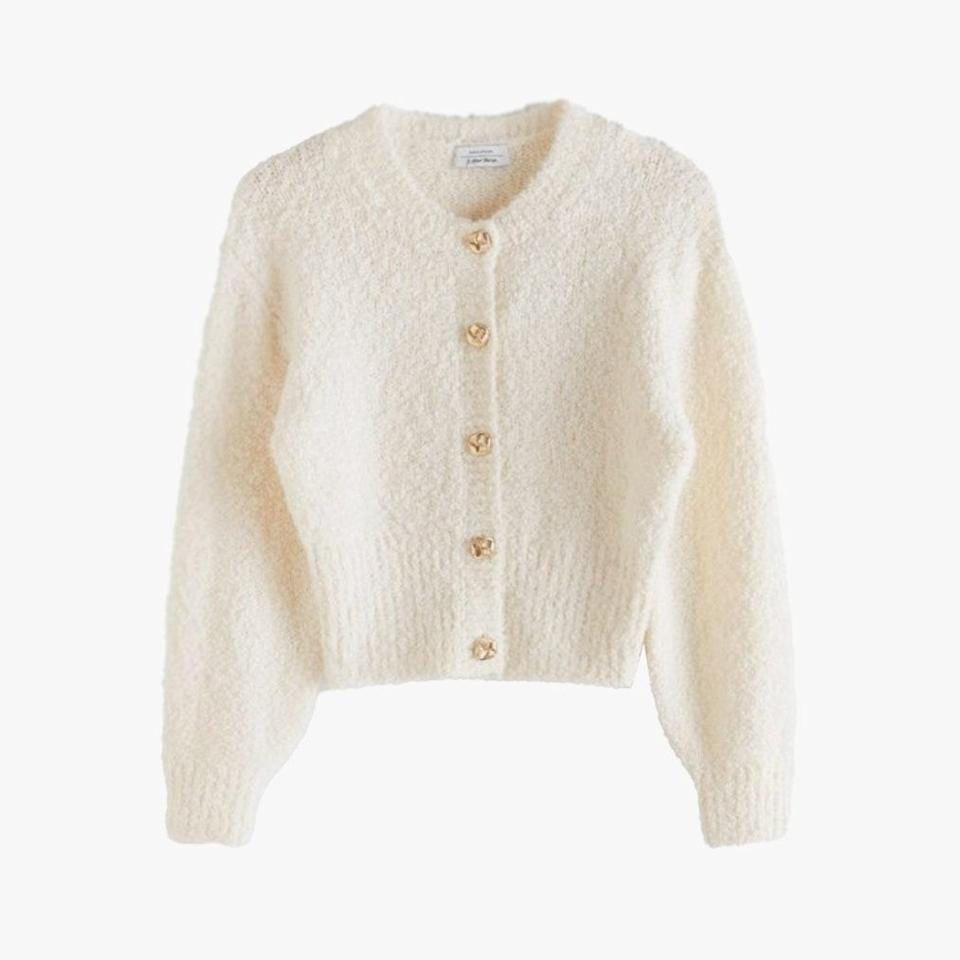 """Add a hint of sparkle to your neutral collection with a gold-button-adorned cardigan. $99, & OTHER STORIES. <a href=""""https://www.stories.com/en_usd/clothing/knitwear/cardigans/product.boucl%C3%A9-knit-cropped-cardigan-white.0847949001.html"""" rel=""""nofollow noopener"""" target=""""_blank"""" data-ylk=""""slk:Get it now!"""" class=""""link rapid-noclick-resp"""">Get it now!</a>"""