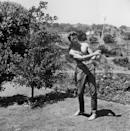 <p>Clint Eastwood practices his golf swing, circa 1968.</p>