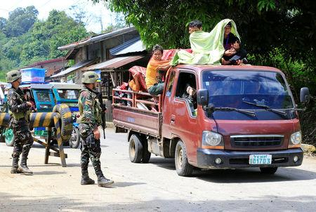 Police chief beheaded and others killed by IS militants in Philippines