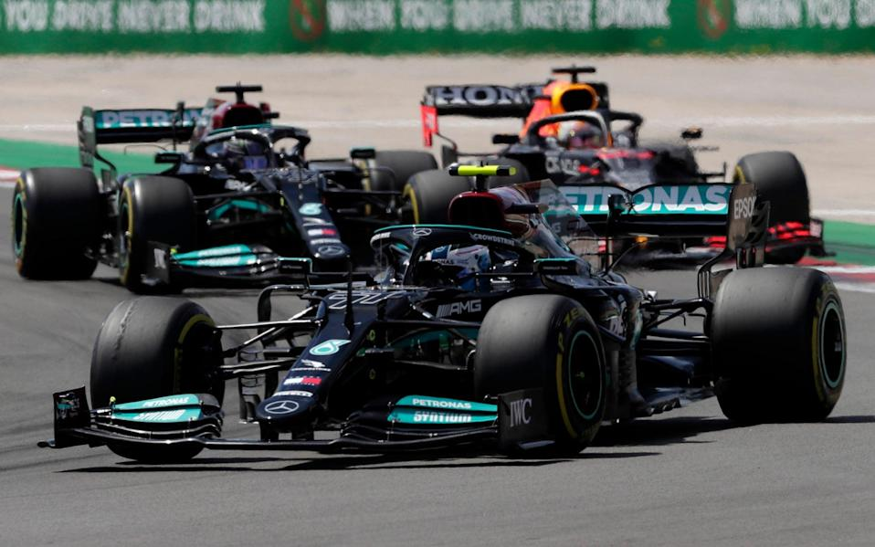 Mercedes driver Valtteri Bottas of Finland leads Mercedes driver Lewis Hamilton of Britain, left, and Red Bull driver Max Verstappen of the Netherlands during the Portugal Formula One Grand Prix at the Algarve International Circuit near Portimao, Portugal, Sunday, May 2, 2021 - AP Photo/Manu Fernandez