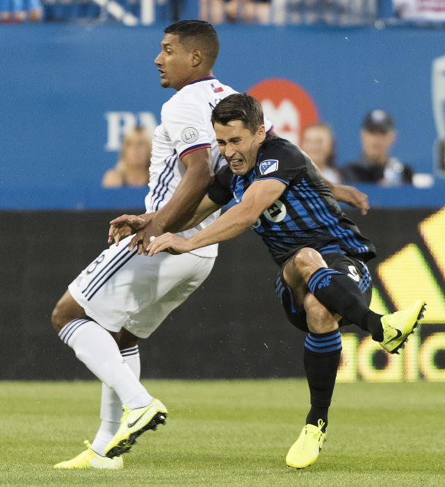 Montreal Impact's Bojan, right, challenges FC Dallas' Bryan Acosta during first-half MLS soccer match action in Montreal, Saturday, Aug. 17, 2019. (Graham Hughes/The Canadian Press via AP)