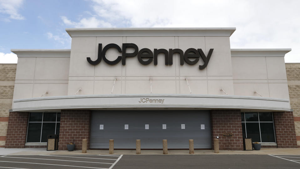 FILE - In this May 8, 2020 file photo, a parking lot at a JC Penney store is empty in Roseville, Mich. J.C. Penney anticipates being out of bankruptcy protection before the December holiday season. The retailer said Wednesday, Oct. 21 that it filed a draft asset purchase agreement under which mall owners Brookfield Asset Management Inc. and Simon Property Group will acquire substantially all of its retail and operating assets through a combination of cash and new term loan debt. (AP Photo/Paul Sancya, File)