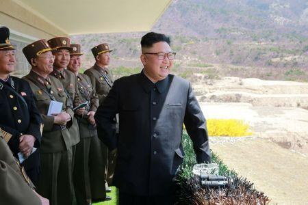 North Korean Leader Kim Jong Un observes a target-striking contest by the Korean People's Army