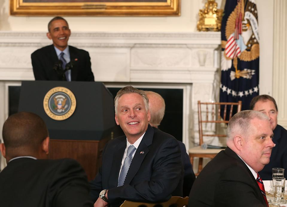 WASHINGTON, DC - FEBRUARY 22: US President Barack Obama (L), Gov. Terry McAuliffe (D-VA) (C), and  Gov. Larry Hogan (R-MD) (R), listen to questions during a meeting with members of the National Governors Association, in the State Dining Room at the White House, February 22, 2016 in Washington, DC. President Obama fielded questions from Governors during their annual visit to the White House.  (Photo by Mark Wilson/Getty Images)