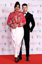<p>Priyanka Chopra wears an ornately decorated floral jacket, accompanied with elegant white trousers and black pumps, while Nick Jonas keeps things classic in a suit with a bow tie.</p>