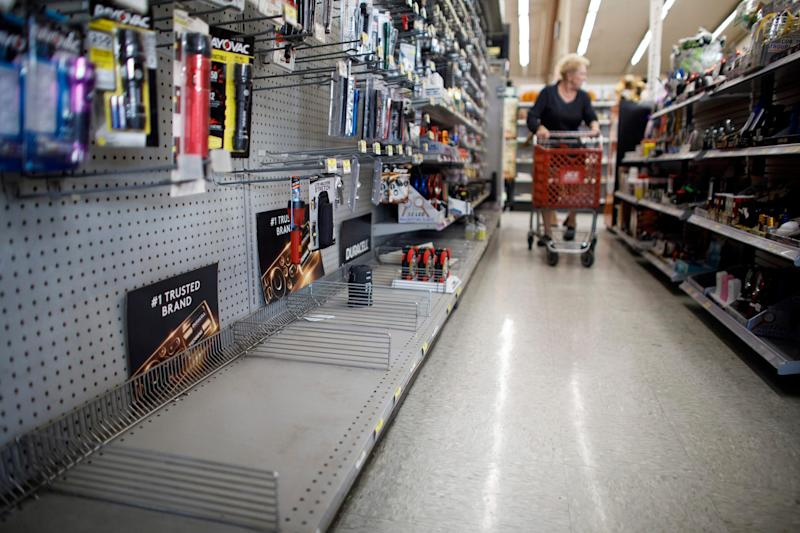 The lantern section is nearly empty at an ACE Hardware store as shoppers prepare for possible power shutoffs in Los Gatos, Calif., Oct. 8, 2019.