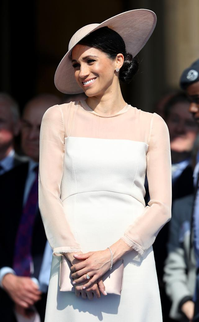 <p>For her debut post-wedding appearance at the Prince of Wales's 70th birthday celebration on May 22, teh duchess gave the nation a glimpse of her new go-to regal bun. (Photo: Getty Images) </p>