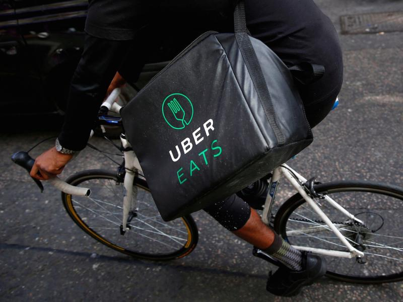 An UberEATS food delivery courier rides his bike in London, Britain September 7, 2016. Picture taken September 7, 2016. To match FOOD-DELIVERY/