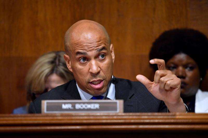 "U.S. Sen. Cory Booker, D-N.J., questions U.S. Attorney General William Barr as he testifies before the Senate Judiciary Committee on ""the Justice Department's investigation of Russian interference with the 2016 presidential election"" on Capitol Hill in Washington, D.C., on May 1, 2019. (Photo: Nicholas Kamm/AFP/Getty Images)"