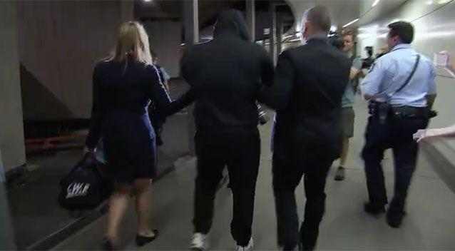 Following the arrest, he was then walked past waiting media. Picture: NSW Police