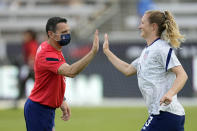 U.S. coach Vlatko Andonovski, left, greets Samantha Mewis as she joins teammates for warmups before an international friendly soccer match against Portugal on Thursday, June 10, 2021, in Houston. (AP Photo/David J. Phillip)