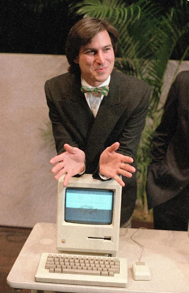 "FILE - In this Jan. 24, 1984, file photo, Steve Jobs, chairman of the board of Apple Computer, leans on the new ""Macintosh"" personal computer following a shareholder's meeting in Cupertino, Calif. Apple on Wednesday, Oct. 5, 2011 said Jobs has died. He was 56. (AP Photo/Paul Sakuma, File)"
