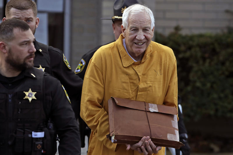 Former Penn State assistant coach Jerry Sandusky, center, leaves the Centre County Courthouse in Pennsylvania after attending a resentencing hearing on his 45-count child sexual abuse conviction on Friday. (AP/Gene J. Puskar)