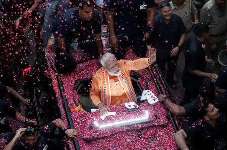 FILE PHOTO: India's Prime Minister Narendra Modi waves towards his supporters during a roadshow in Varanasi, India, April 25, 2019. REUTERS/Adnan Abidi/File Photo