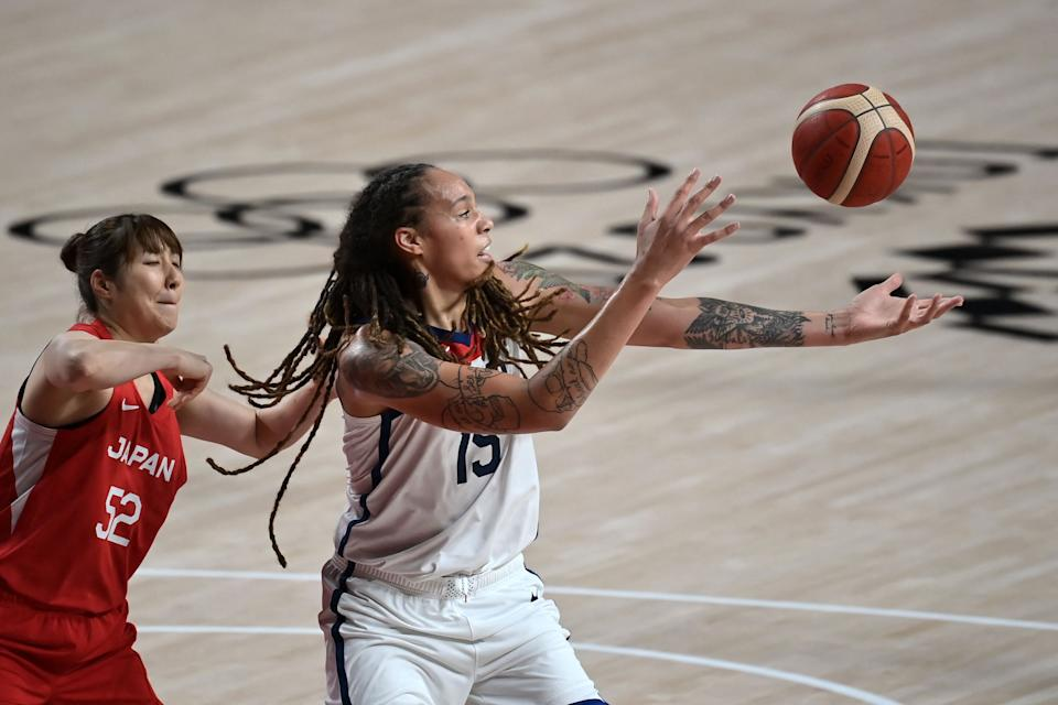 Japan's Yuki Miyazawa (L) fights for the ball with USA's Brittney Griner in the women's preliminary round group B basketball match between Japan and USA during the Tokyo 2020 Olympic Games at the Saitama Super Arena in Saitama on July 30, 2021. (Photo by Aris MESSINIS / AFP) (Photo by ARIS MESSINIS/AFP via Getty Images)