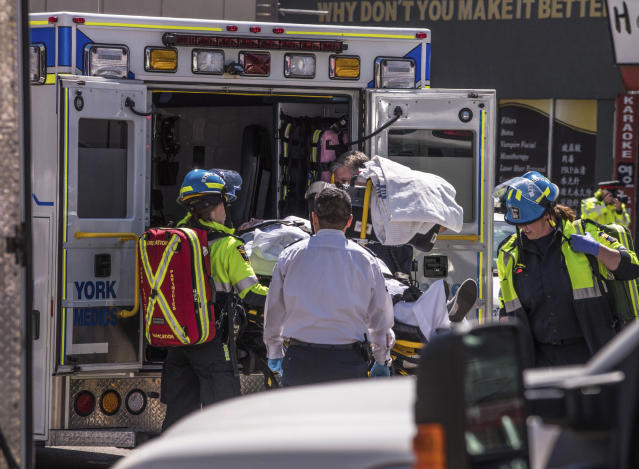 <p>A injured person is put into the back of an ambulance in Toronto after a van mounted a sidewalk crashing into a number of pedestrians on Monday, April 23, 2018. (Photo: Aaron Vincent Elkaim/Canadian Press) </p>