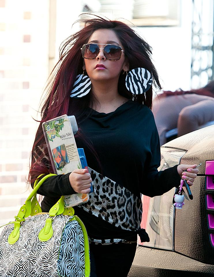 "<p class=""MsoNoSpacing"">Nicole ""Snooki"" Polizzi spent weeks denying she was pregnant – all while stepping out in oversized coats and carrying huge purses, like she did here on February 28. Finally, on March 7, the ""Jersey Shore"" star admitted the obvious: she and fiance Jionni LaValle are going to be parents.</p>"