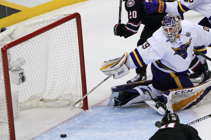 Minnesota State goaltender Dryden McKay (29) can't stop a shot by St. Cloud State's Kyler Kupka (10) that gets by for a goal during the first period of an NCAA hockey semifinal game at the Frozen Four in Pittsburgh, Thursday, April 8, 2021. (AP Photo/Keith Srakocic)