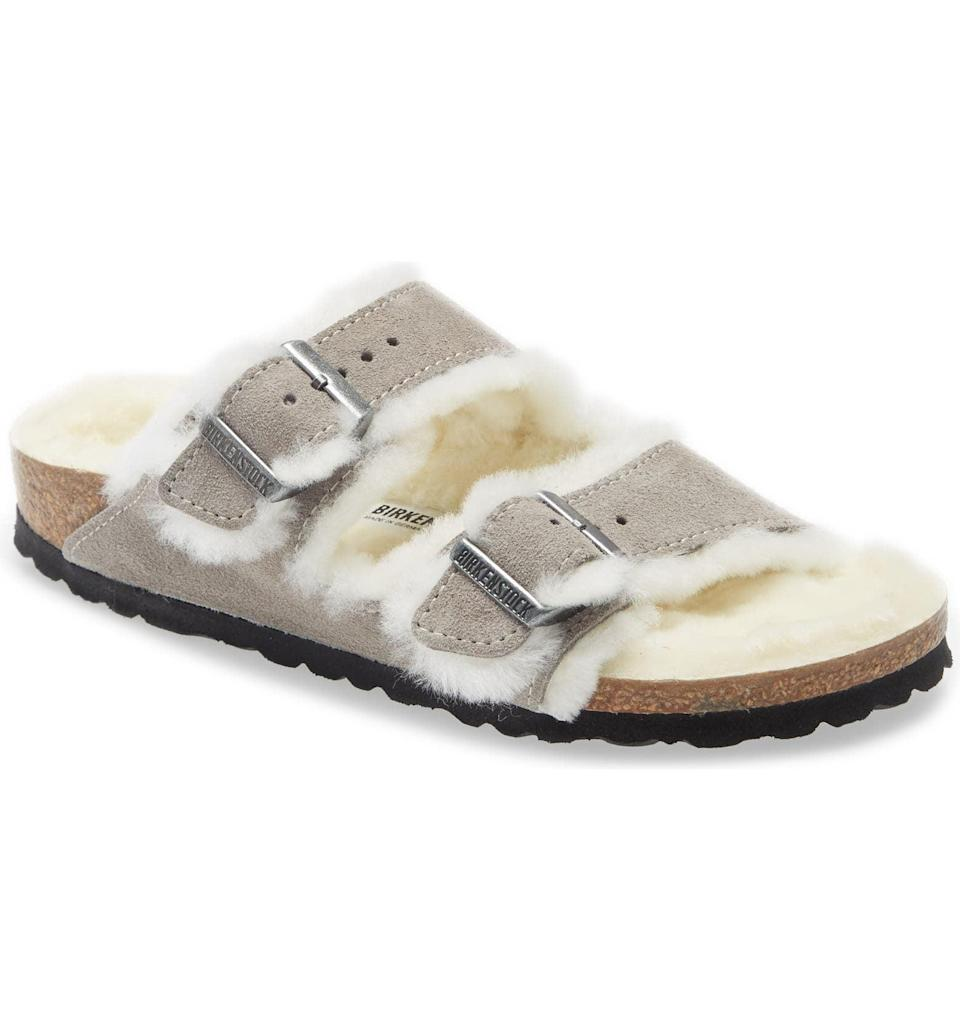 <p>With Cancers, cozy wins out in the end, but they'll actually want to leave the house in these cute <span>Birkenstocks Arizona Genuine Shearling Slide Sandals</span> ($150).</p>