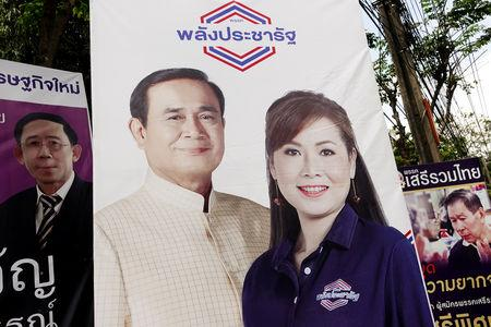 A picture of Thailand's Prime Minister Prayuth Chan-ocha is seen next to a candidate of Palang Pracharat party on an election campaign poster in Bangkok, Thailand, March 9, 2019. REUTERS/Athit Perawongmetha